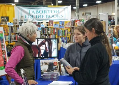 Margret with clients at Taborton Equine Books booth.